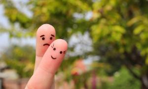 2019/07/finger-art-of-couple-woman-is-cheerful-man-is-sad-picture-id680258854.jpg