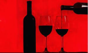 2012/01/droga-do-wolnosci-bottle-of-wine-and-glass-with-red-wine-on-red-background-picture-id936538030.jpg