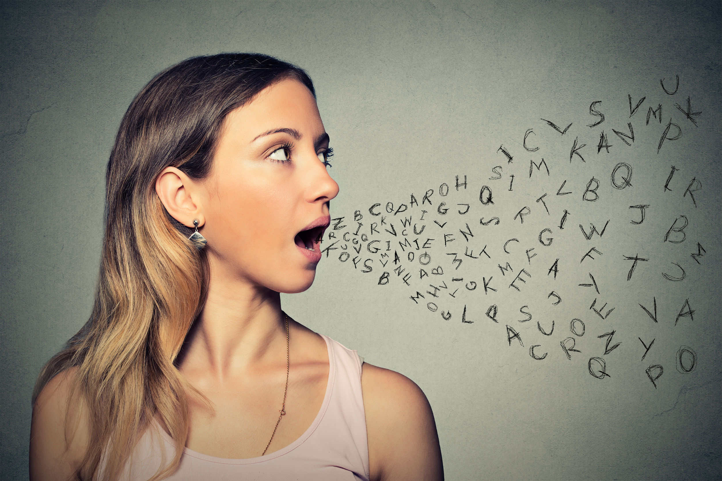 42813617 - woman talking with alphabet letters coming out of her mouth.