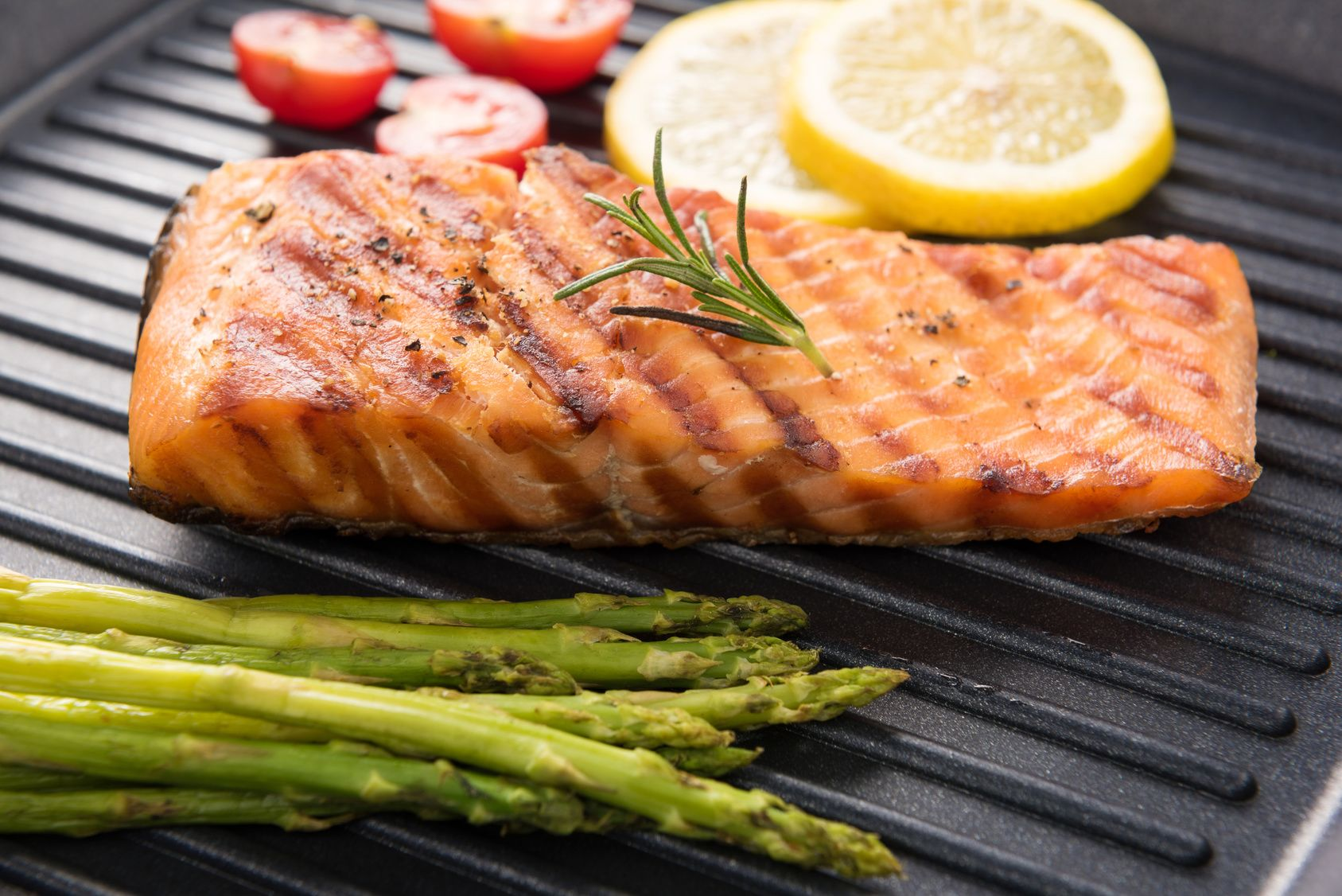 Grilled salmon cooked BBQ on a pan.