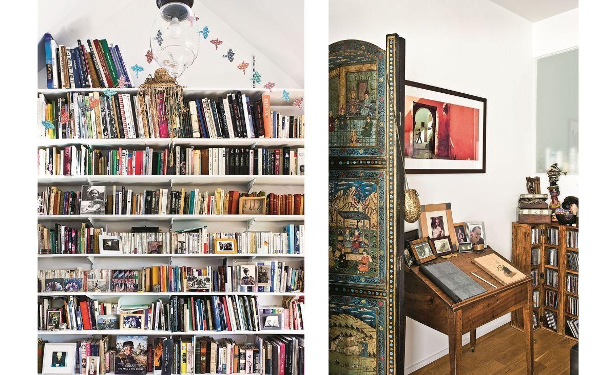 Ściana ksiażek i albumów w -pracowni, obok biurka - pod ręką. Na zdjęciu obok dziecinne biureczko pochodzące z domu rodzinnego w Paryżu, parawan to prezent od przyjaciół z Indii, a zdjęcie zrobił w Maroku przyjaciel, francuski fotograf Bruno Barbey. (Fot. Jakub Pajewski)