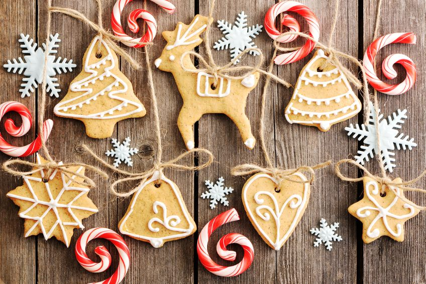 16235204 - christmas homemade gingerbread cookies over wooden table