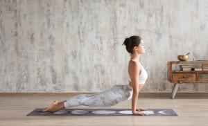 2019/11/young-indian-girl-doing-yoga-fitness-exercise-indoor-wellness-concept-picture-id1181866274.jpg