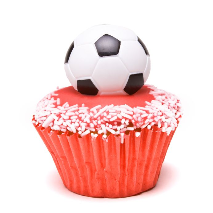 7153789 - soccer cup cake in the colours of england red and white for football supporters.