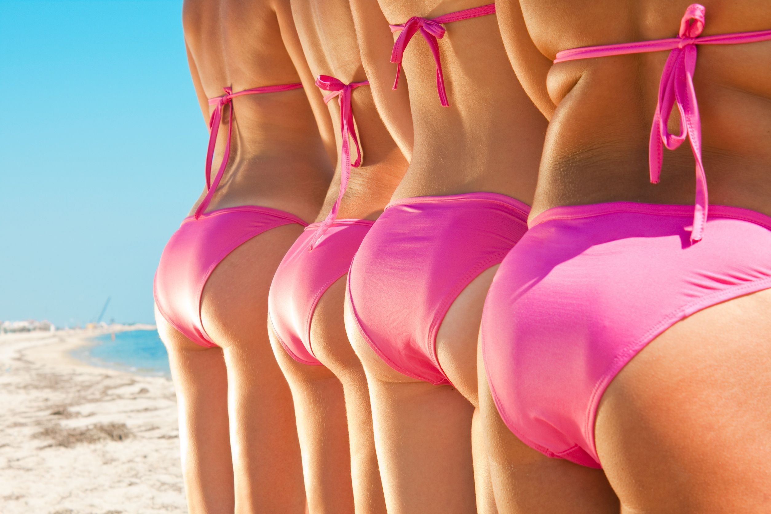 7075683 - side view of young girls bottom in pink bikini