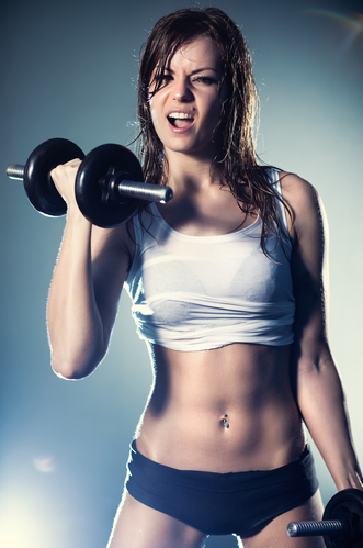 Young strong sexy woman with dumbbells. With flash effect.