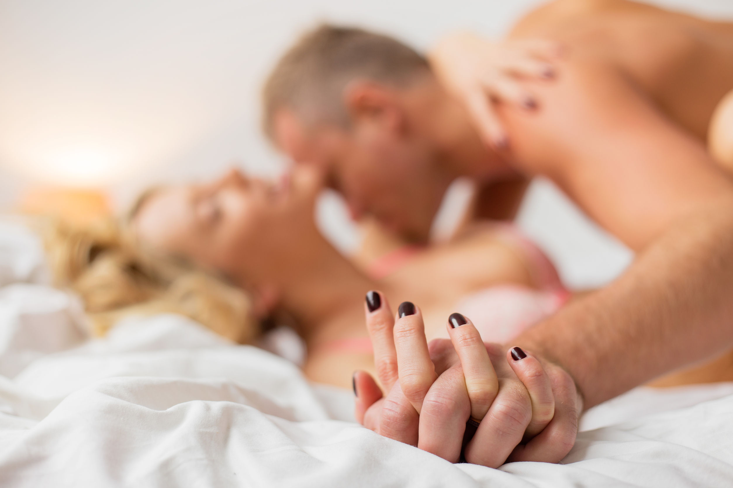 48756735 - man and woman holding hands while making love