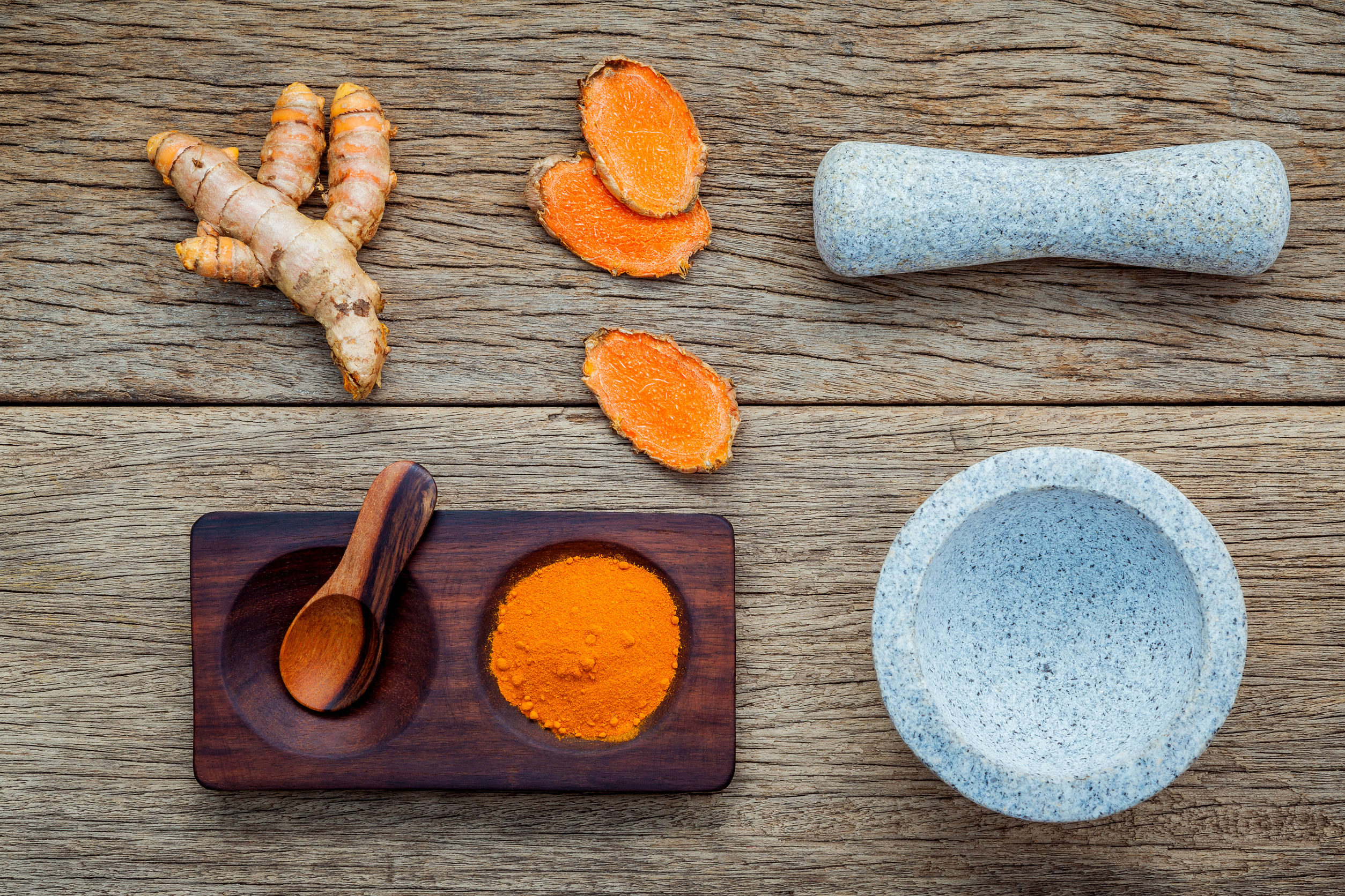 61128746 - homemade scrub curcumin powder and curcumin roots with white mortar set up on old wooden background.