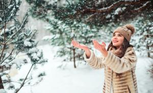 2019/11/happy-woman-catching-snowflakes-on-the-walk-in-snowy-winter-forest-picture-id1069493172.jpg