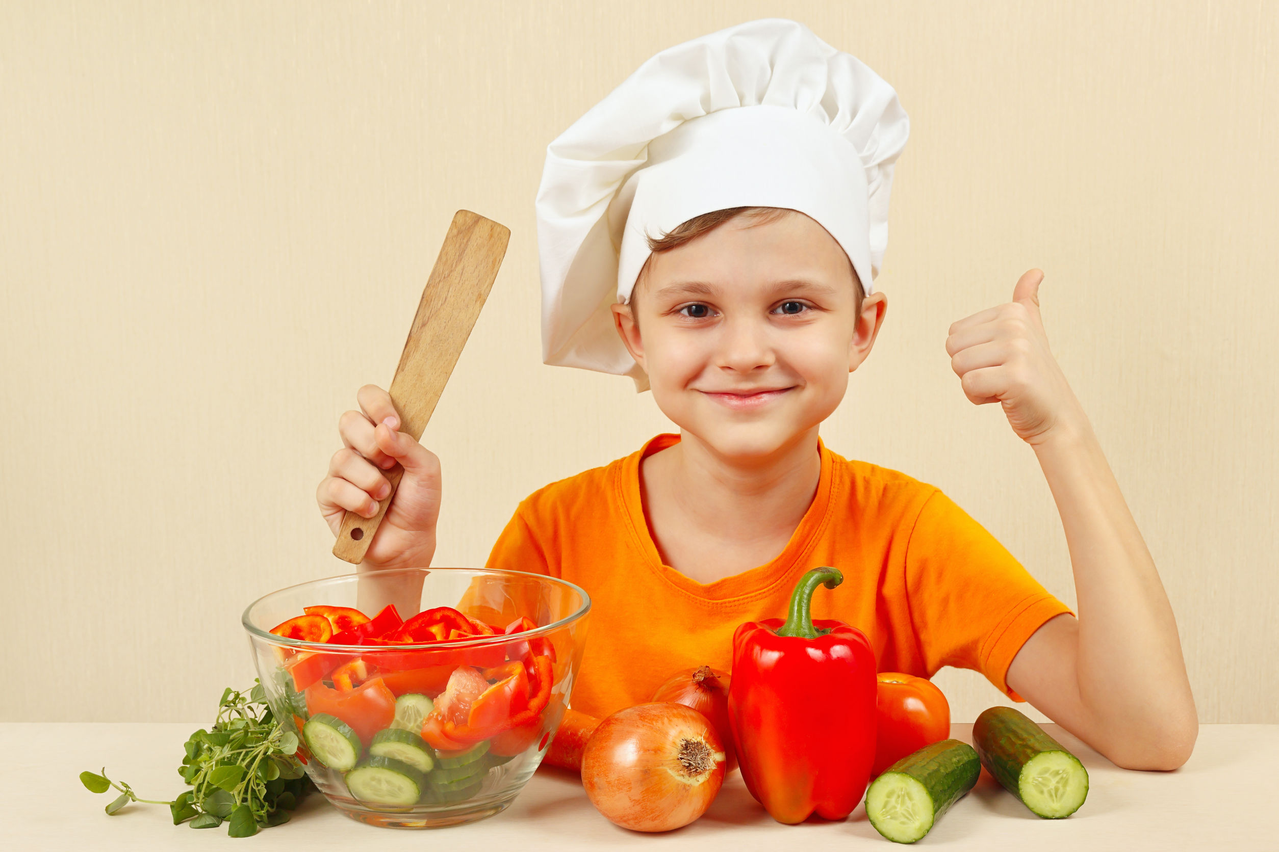51760880 - little funny chef shows how to cook a vegetable salad