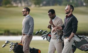 2019/07/multiethnic-golfers-holding-bags-with-golf-clubs-and-walking-on-golf-picture-id803113482.jpg