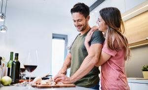 2019/12/loving-joyful-young-couple-embracing-and-cooking-together-having-fun-picture-id996097574.jpg