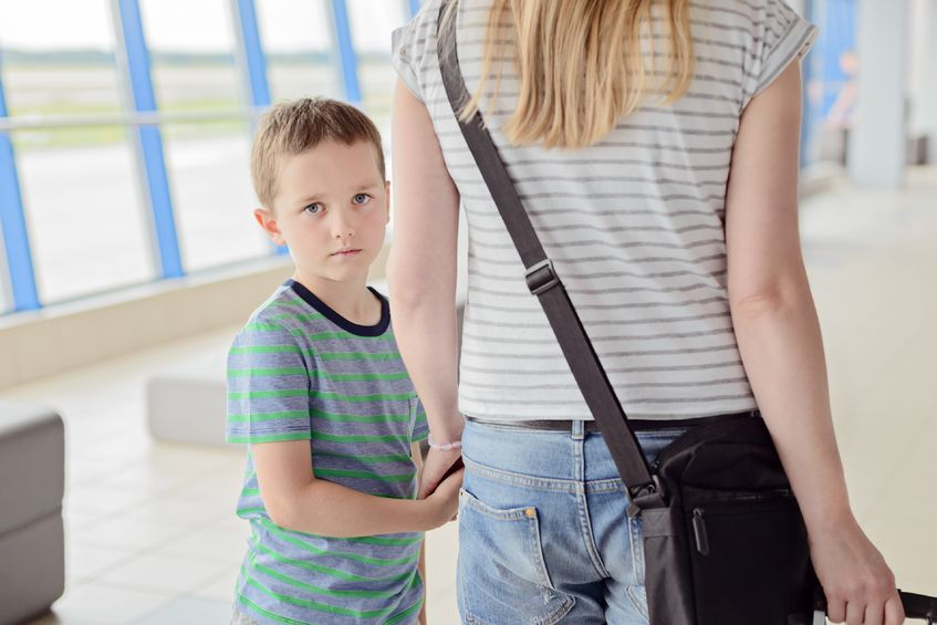 59175513 - sad child, boy travelling with his mother