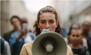 2021/01/odzyskana-solidarnosc-female-activist-protesting-with-megaphone-during-a-strike-picture-id1222350230.jpg