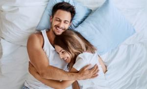 2019/06/top-view-of-beautiful-happy-young-couple-lying-on-bed-and-hugging-picture-id996097632.jpg