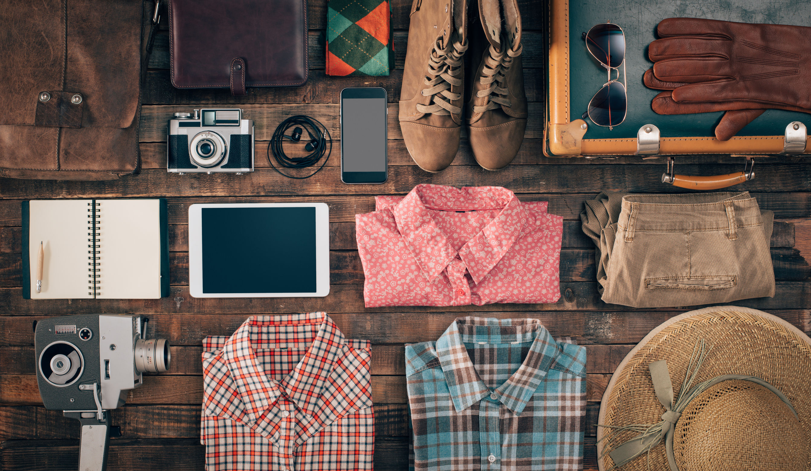 42512672 - hipster vintage accessories and clothing on a wooden table before packing, travel and vacations concept, top view