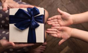 2011/12/mother-giving-a-big-gift-boxes-to-her-kid-picture-id620370582.jpg
