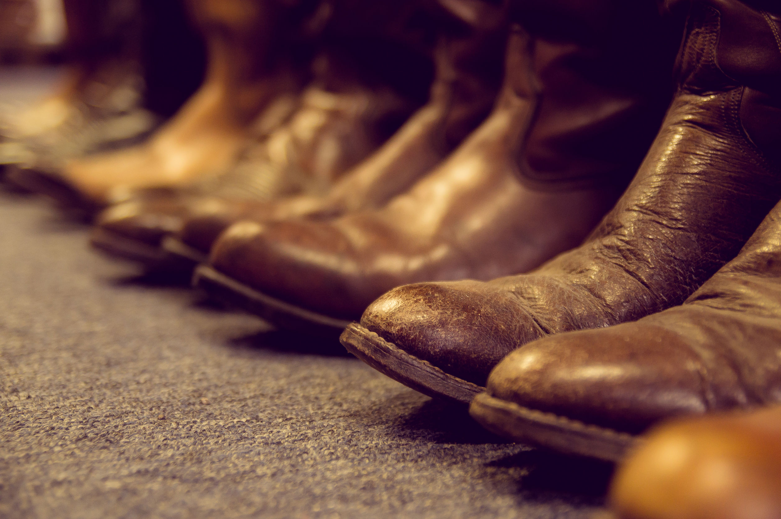32455449 - brown vintage leather boots aligned selective focus