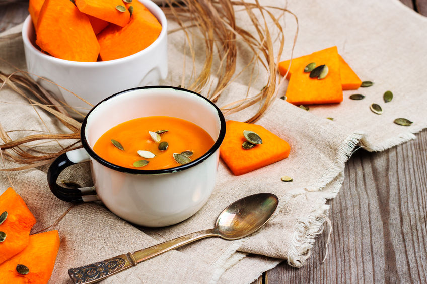 49020796 - still life, food and drink, seasonal concept. fresh orange pumpkin soup in a mug on a rustic wooden table. selective focus